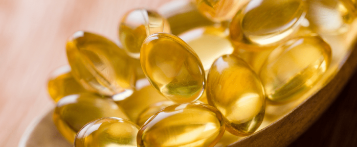 A spoon contains omega-3 capsules