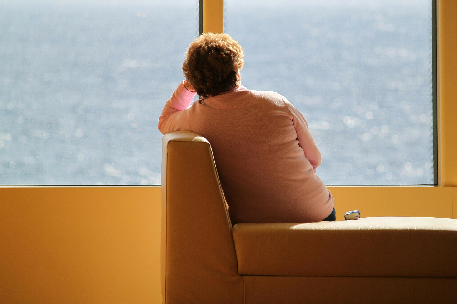 A senior woman sitting alone on the bench