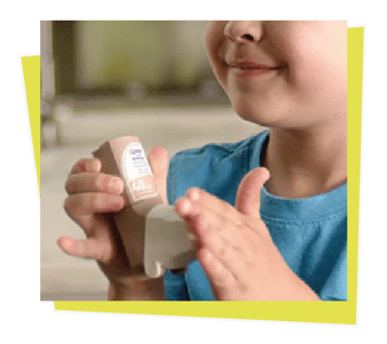 asthma inhalers- a kid finish using medical device.
