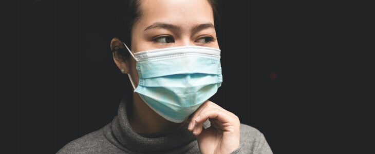 The lady wearing the grey T-shirt and surgical masks.