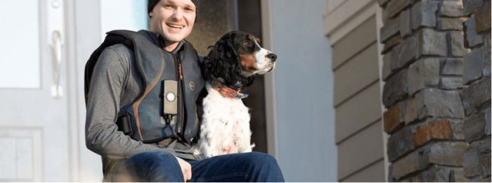 Adult_Vest_Therapy- A man wear monarch airway system and a dog.