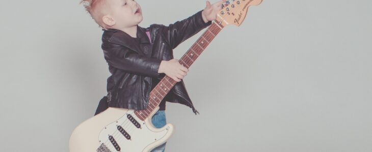 A kid playing electric guitar