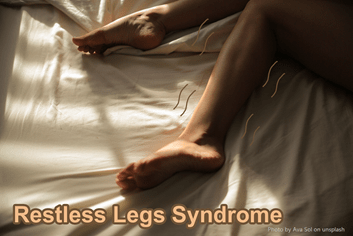 A person's feet on the bed