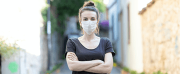 A woman wearing a surgical mask