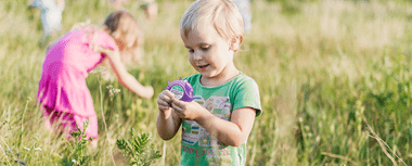 Some children playing in meadow